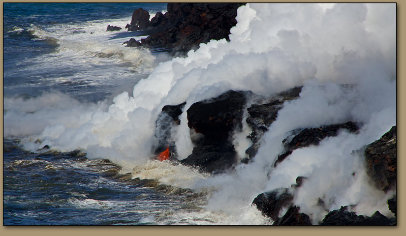 Lava flows into the Pacific Ocean.